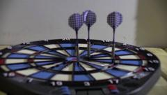 Competitors throw at target with blue and pink arrows 10 - stock footage