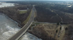 Aerial view of traffic moving towards bridge during Ohio Winter Stock Footage