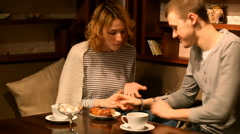 Happy young couple eating cake and drinking tea.The guy feeds the girl Stock Footage