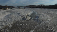 Low angle view of camera moving over ice melting on Maumee River in Ohio Stock Footage