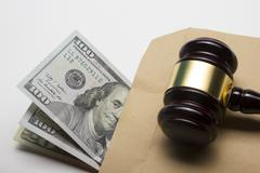 Judge gavel and american dollars on white background Stock Photos