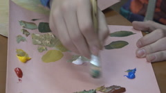 Mother and children painting oil on canvas Stock Footage