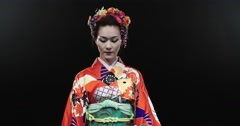 4K beautiful Japanese geisha dancing on stage and posing for the camera with Stock Footage