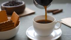 Hot coffee. espresso in cup. Pour coffee in a cup. - stock footage