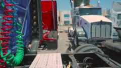 Slow pan of empty bed of freight liner truck to the connecting cables in back Stock Footage