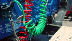 Pan down of multi-colored connecting cables in back of freight liner truck Stock Footage