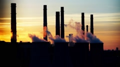Central heating and power plant on beautiful colorful sunset background - stock footage