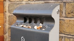 Public smoking area ash tray Stock Footage