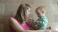 Mother with son play with plasticine and talking Stock Footage