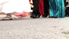 Feet of men and women are in a procession wedding on a small country town Stock Footage
