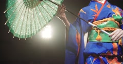 4K beautiful Japanese geisha dancing on stage and posing for the camera with an Stock Footage