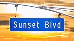 Sunset Blvd Sign with Time Lapse Sunset Sky - stock footage