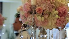 Flower bouquets, placed on tables where guests are to arrive Stock Footage