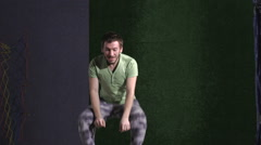 A young man in a T-shirt. Jumping on a trampoline is ridiculous Stock Footage