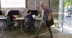 Designer Arriving For Work In Modern Office Shot On R3D Stock Footage