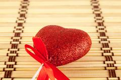 Valentine day concept - heart shaped lolly pop on wood background Stock Photos
