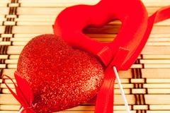 Valentine day concept - heart shaped lolly pop on wood background - stock photo