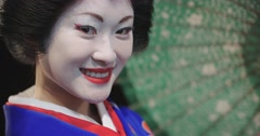 4k Close up of a beautiful Japanese Geisha posing for the camera, slow motion Stock Footage