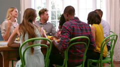 Friends Sitting Around Table At Dinner Party Shot On R3D Stock Footage