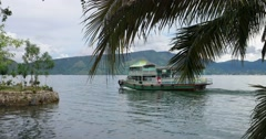 Lake Toba Landscape with Boat and Palm Tree Stock Footage