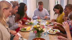 Friends Sitting Around Table At Dinner Party Shot On R3D - stock footage