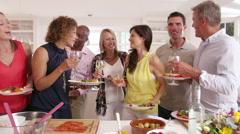 Mature Friends Enjoying Buffet At Dinner Party Shot On R3D - stock footage
