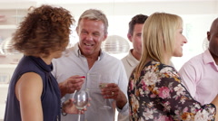 Group Of Mature Friends Enjoying Dinner Party Shot On R3D - stock footage