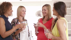 Female Friends Drinking Wine At Dinner Party Shot On R3D - stock footage