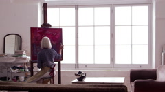 Artist Works On Painting In Daylight Studio Shot On R3D Stock Footage