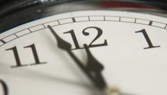 Closeup of hands on clock face Stock Footage