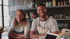 Couple Running Coffee Shop Behind Counter Shot On R3D - stock footage