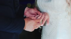 The bride wears a wedding ring on the groom Stock Footage