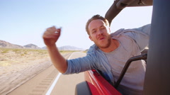 Young Man In Back Seat Of Convertible Car Shot On R3D Stock Footage
