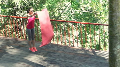 Young, sporty woman unfold mat on terrace, super slow motion 120fps Stock Footage