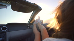 Female Passenger Relaxing In Convertible Car Shot On R3D Stock Footage
