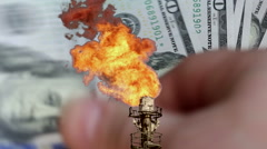 Layered footage with the dollar and oil torch Stock Footage
