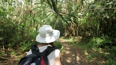 Girl walking in the amazonian jungle Stock Footage