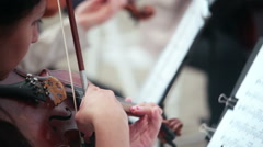 Women playing stringed instruments violin, cello Stock Footage