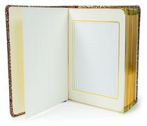 Opened book with blank pages and decorative frame for text - stock photo