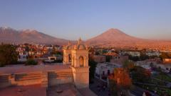 Arequipa volcano at sunset, church in the foreground Stock Footage