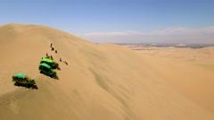 Desert sand boarding Stock Footage
