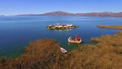 Flight over Uros islands, Titicaca lake Stock Footage