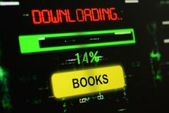 Downloading books - stock photo