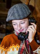 Teenage girl speaking by old vintage telephone - stock photo