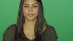 Young woman being flirty, on a green screen studio background - stock footage