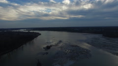 Aerial view, camera moving backwards over thawing river Stock Footage