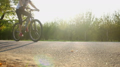 Female cycle sport professional training, riding bike in beautiful city park Stock Footage