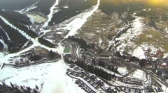 Aerial shot of ski resort Bukovel with snow covered slopes at spring - stock footage