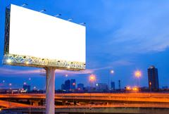 Stock Photo of Blank billboard at night for advertisement