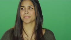 Young woman starting to cry, on a green screen background Stock Footage